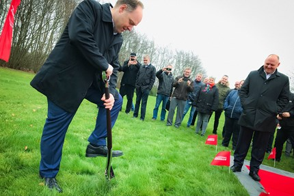 Danfoss leader with shovel breaking ground on new location